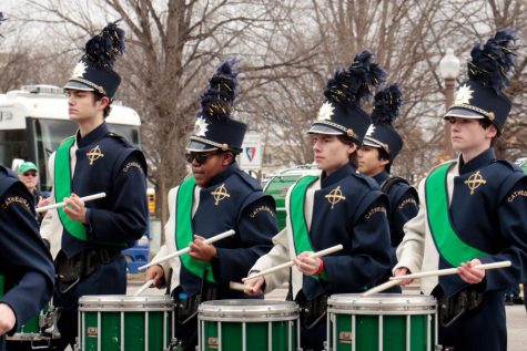 Members of the marching band take part in the St. Patrick