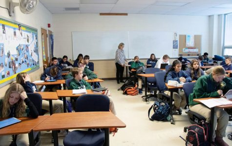 Theology teacher Mrs. Cece Kasberg teaches a theology class -- now known as a religion class -- last spring.
