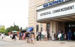 Friends and family members arrive at the Old National Centre for last year's graduation ceremonies.