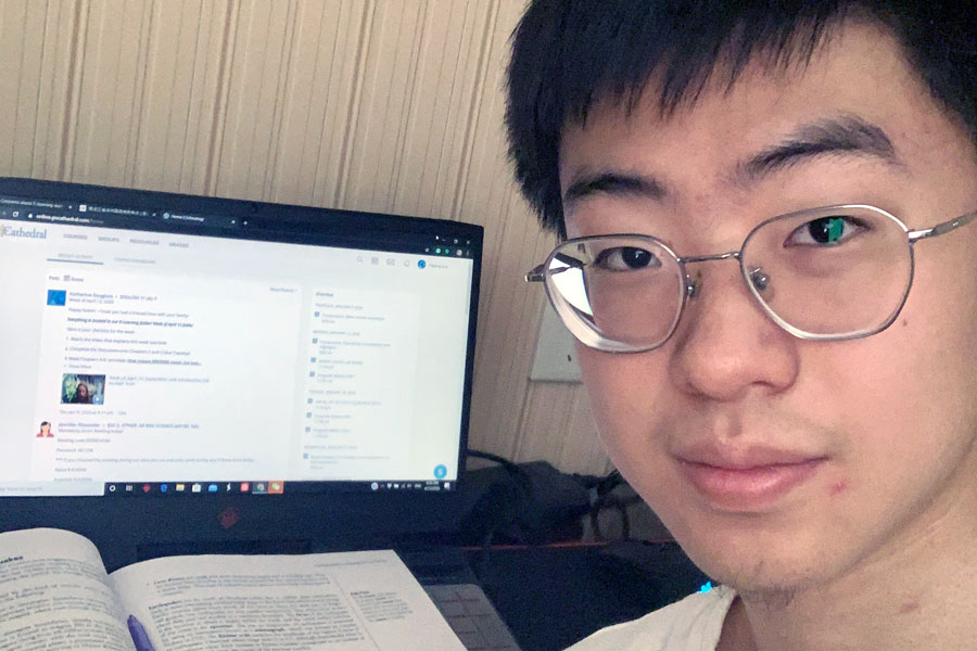 Junior+Deviin+Liu+works+on+his+Scholoogy+assignments+in+his+hotel+room+in+China%2C+where+he+is+in+quarantine+for+14+days.+