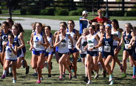 The women's cross-country team competes last fall. The squad will join the other fall sports when practice resumes in July.
