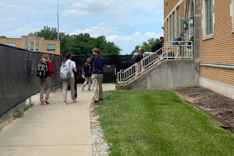 Students prepare to enter Loretto Hall on Aug. 13, the first day of school.