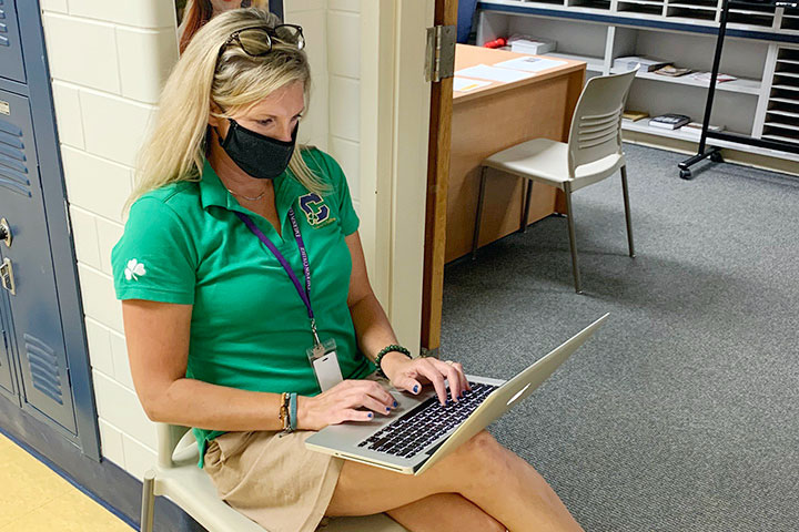 Counselor+Mrs.+Beth+Brandes+works+outside+her+office+on+the+first+floor+of+Kelly+Hall.+She+outlined+steps+seniors+need+to+take+now+to+meet+initial+college+application+guidelines.+