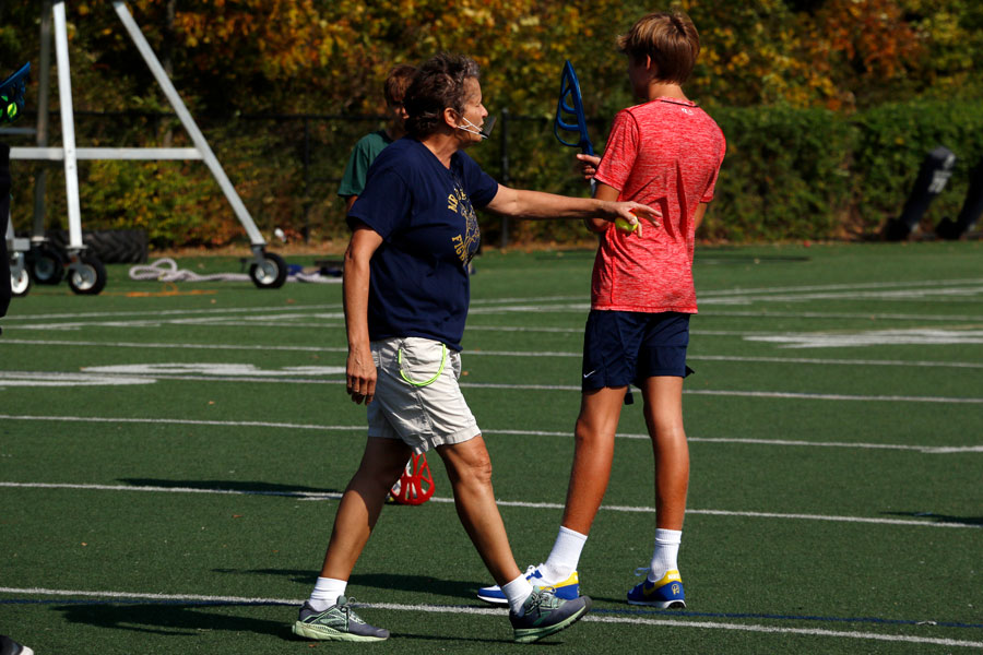 Health teacher Ms. Rhonda Low gives directions during a PE class on the football field.