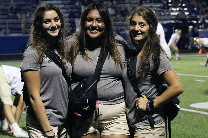 Football managers, from left, seniors Lisa Fallouh, Eilya Mayo and Julia Reasginer, have adjusted to changes in the routines due to the Covid-19 pandemic.