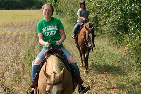 Members of the Horse Club are riding in pairs to be sure to maintain social distancing.
