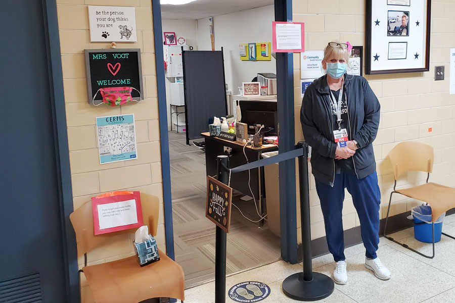 School nurse Mrs. Marianne Vogt stands outside her office on the first floor of Kelly Hall.