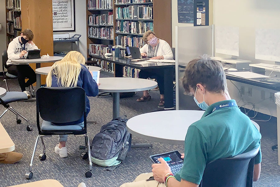During G period on Sept. 22, social studies teacher Sr. Mary Ann Stewart checks out the video monitor. Sr. Stewart is instructing all of her classes in the library this year.
