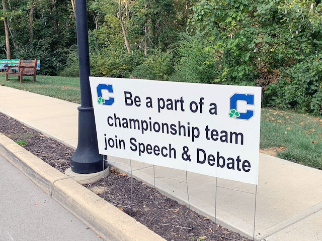 A+sign+on+the+Hill+promotes+the+award-winning+speech+and+debate+team.+