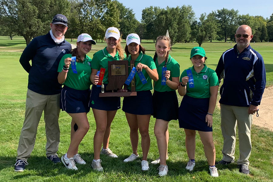 The women's golf team shows off its Sectional championship trophy.