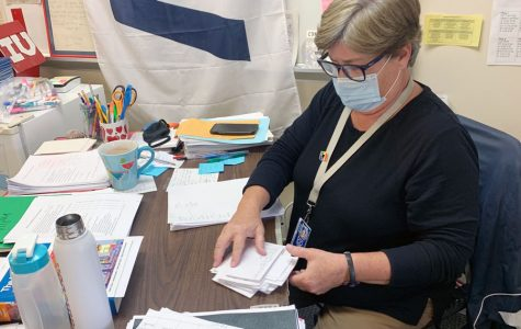 English teacher Ms. Laurie O'Brien works in her classroom on the second floor of Loretto Hall.