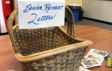 A basket in the faculty workroom in Kelly Hall provides teachers a place to drop off letters to senior retreat participants.