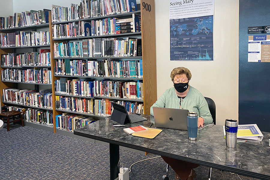 Sr. Mary Mary Ann Stewart prepares for her next social studies class in the library.