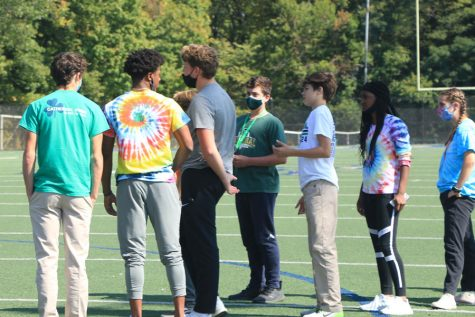 Earlier in the school year, senior peer mentors gathered with the freshmen on the football practice field.