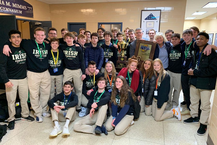 Last year's wrestling team shows off the 2020 State championship trophy.