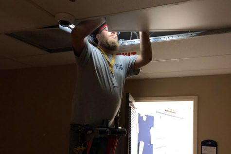 On Jan. 8, a worker installed new LED lighting in the hallway outside the classroom of Mrs. Lisa Blamey.