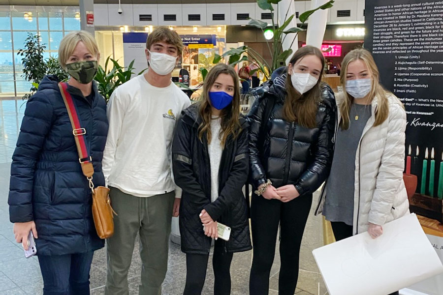 From left, host mother Mrs. Becky Van Rooy, host brother and junor Fisher Van Rooy host sister and freshman Anna Van Rooy, exchange student Julia Wesjohann and host sister and freshman Maggie Van Rooy gather in the Indianapolis International Airport to welcome their guest from Germany.