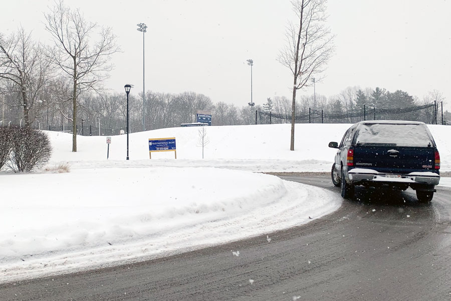 On the morning of Feb. 18, a driver navigates the traffic circle at the top of the Hill.