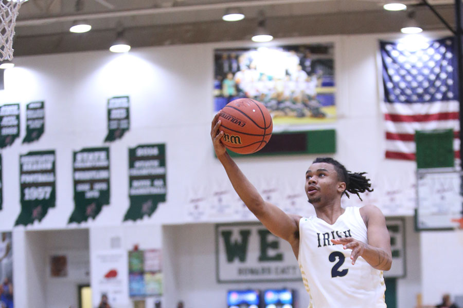 During the City tournament championship game, senior Vincent Brady gets loose for two points. The Irish won the City title with a 69-59 win over Crispus Attucks. The team now heads into Sectional play, taking on Lawrence North on March 3 at Tech.