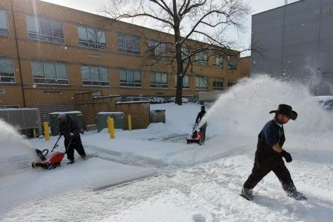 While you were cozy and warm in front of your iPad during the eLearning  day on Feb. 16, crews were spending hours removing snow from the parking lots and sidewalks.