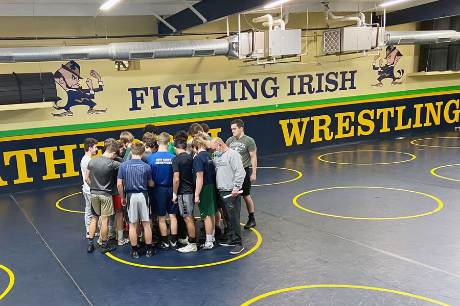 Wrestlers and coaches after after a recent practice.