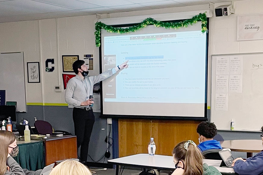 During his E period personal financial responsibility class, Mr. Brendan Surane reviews material with his students. Surane plans to have one of his courses next year with students operating a coffee shop in the Innovation Center.