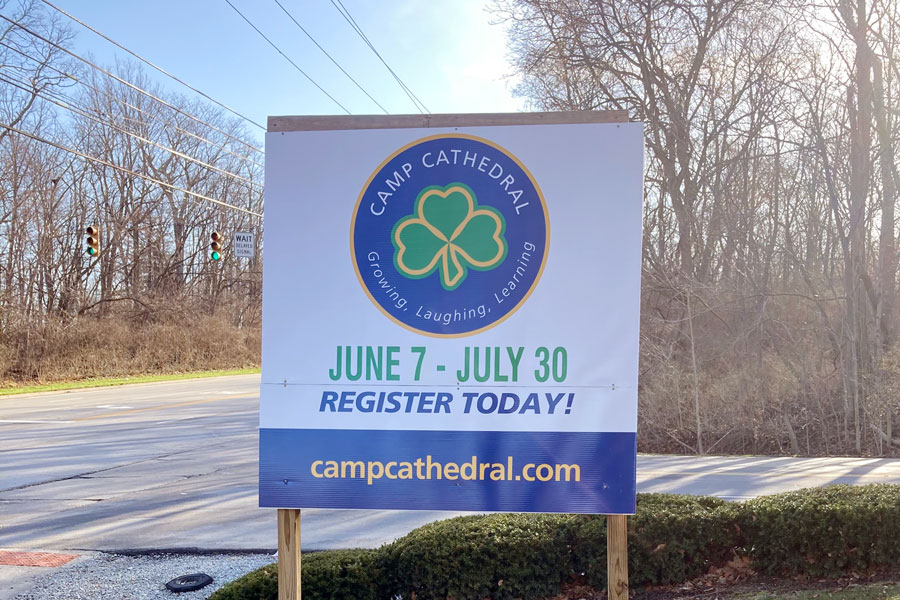 A sign at the bottom of the Hill on East 56th Street promotes this summer's Camp Cathedral.