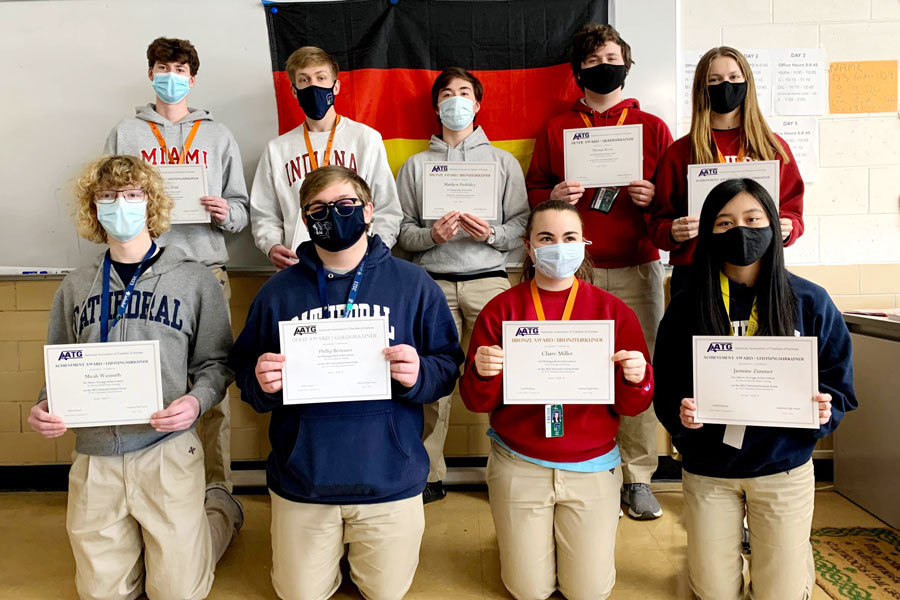 Students show off their awards from the National German Examination. They are, front row, from left, Micah Wasmuth, Phillip Bernauer, Claire Miller and Jasmine Zimmer; back row, Alex Pohl, Hans Klemm, Matthew Fiedeldey, Tom Kress and Emma Kress.