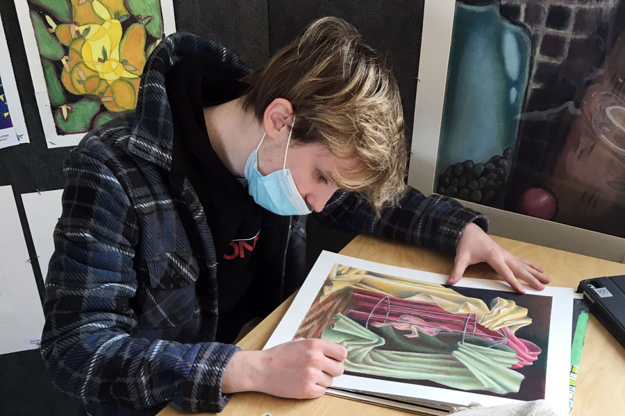 Senior Hays Teasley puts the finishing touches on one of his works of art.