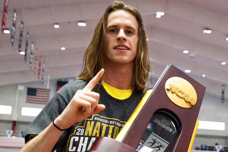 Cole Hocker '19 shows off the indoor men's track and field national championship trophy. Hocker now turns his attention to the Summer Olympics.