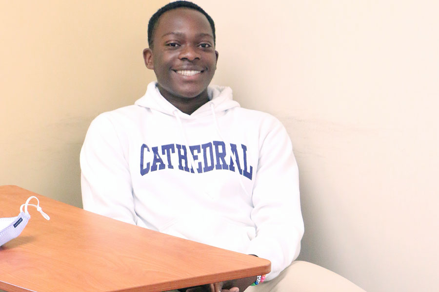 Sophomore Josh Omoruyi gets settled in to his seat before the start of his speech class with Mrs. Melinda Bundy.