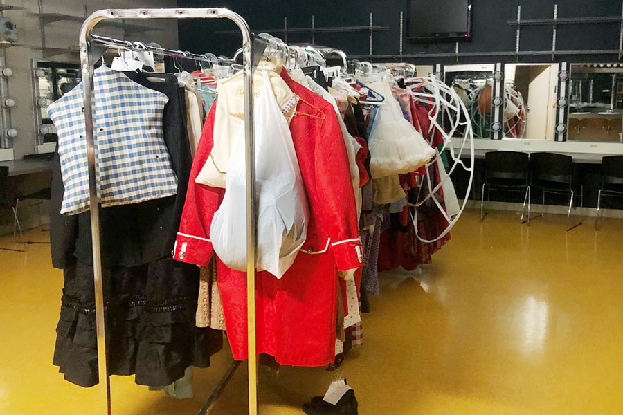 In+the+girls%27+dressing+room%2C+costumes+for+%22Alice+in+Wonderland%22+are+ready+for+their+actors+to+wear.+