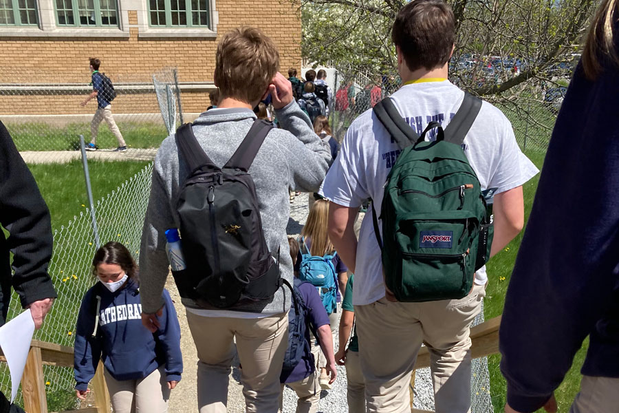 Students walk from Kelly to Loretto on April 14 during a passing period. The lengths of next year's passing periods are pretty much set, but other details of the daily schedule have yet to be determined, according to Principal Mrs. Julie Barthel.