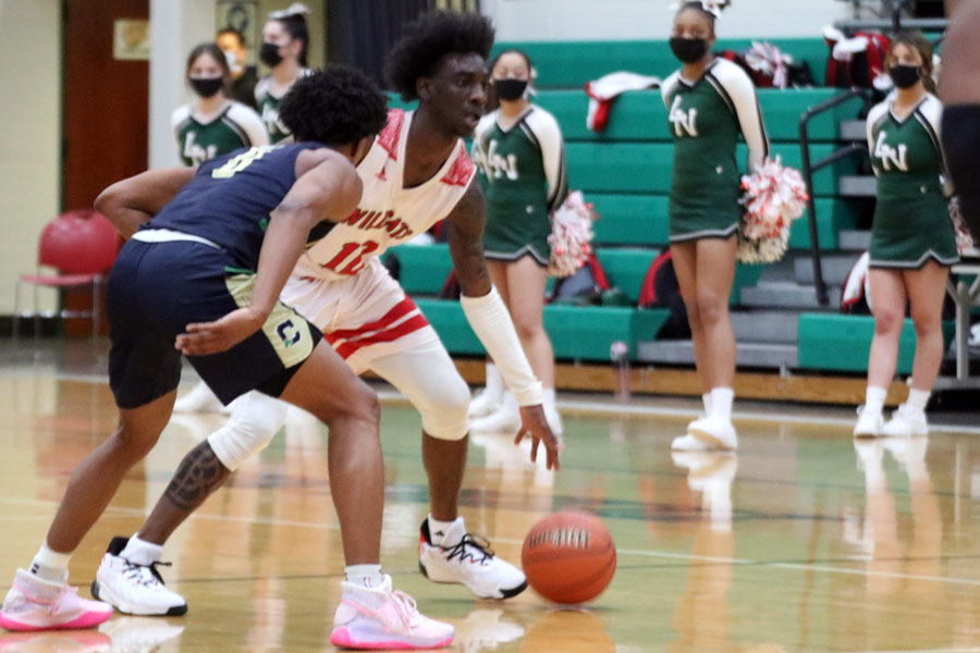 The men's basketball team, shown in action during the first game of the Sectional, will play in the Hall of Fame Classic at New Castle next season.