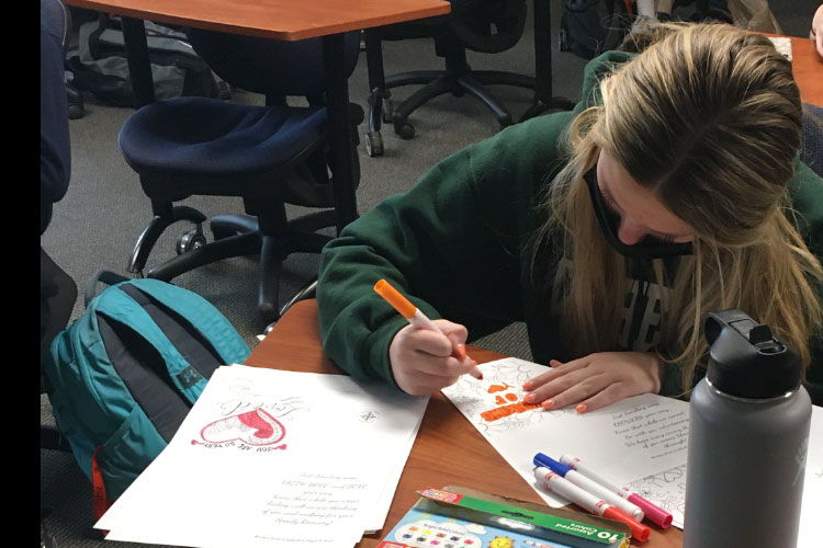 Sophomore Gabrielle Blamey colored greeting cards to help complete her required service hours.