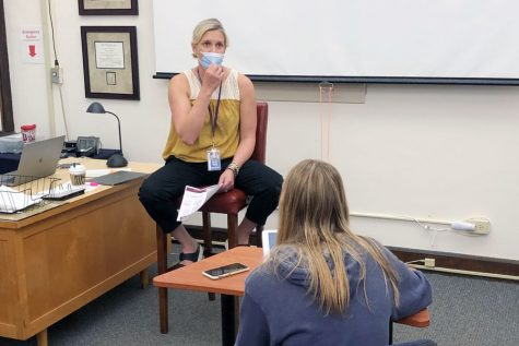 Counselor Mrs. Beth Brandes participated in a presser with the newspaper staff during E period on May 4.