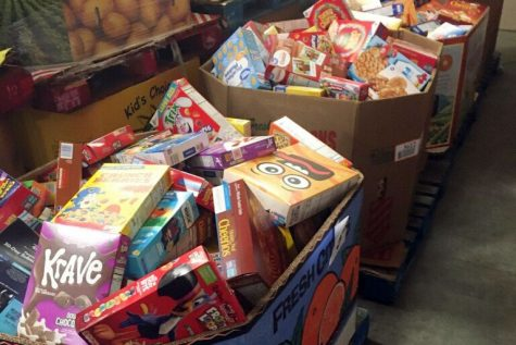 Boxes of cereal await delivery to local agencies.