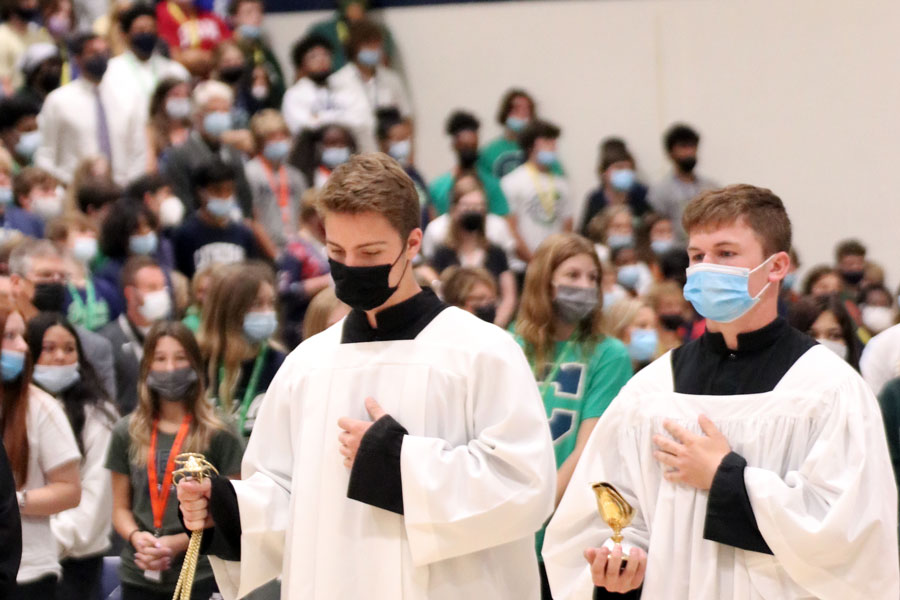 As one of the events celebrating the schools 103rd birthday, students and teachers gathered in the Welch Activity Center for Mass.