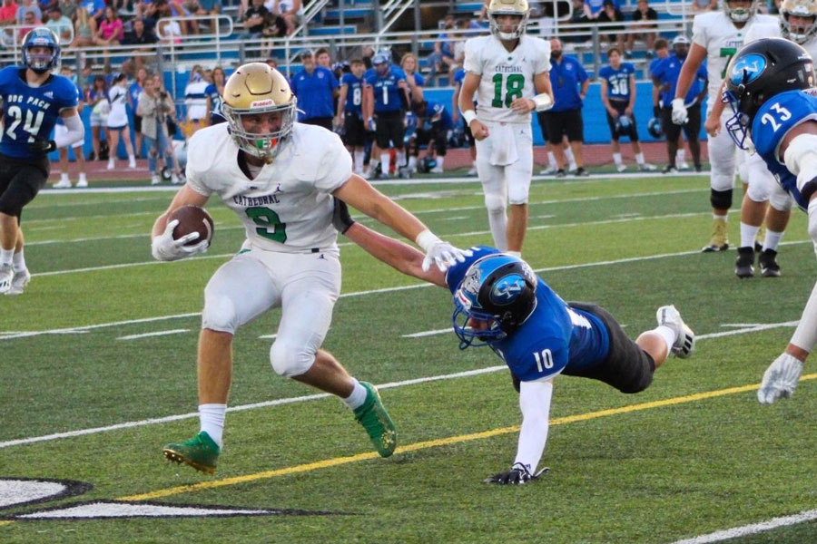 Senior running back Seth Mencer strong arms the Columbus North defense during his teams 37-13 win over the Bull Dogs.