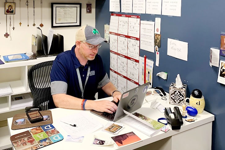 Director of campus ministry Mr. Dave Neeson works in his office in the Sheil Student Life Center.