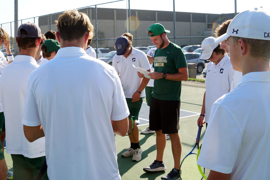 Assistant Coach Mr. Cole Hepp gives directions to the mens tennis team at the regular season match at Noblesville.