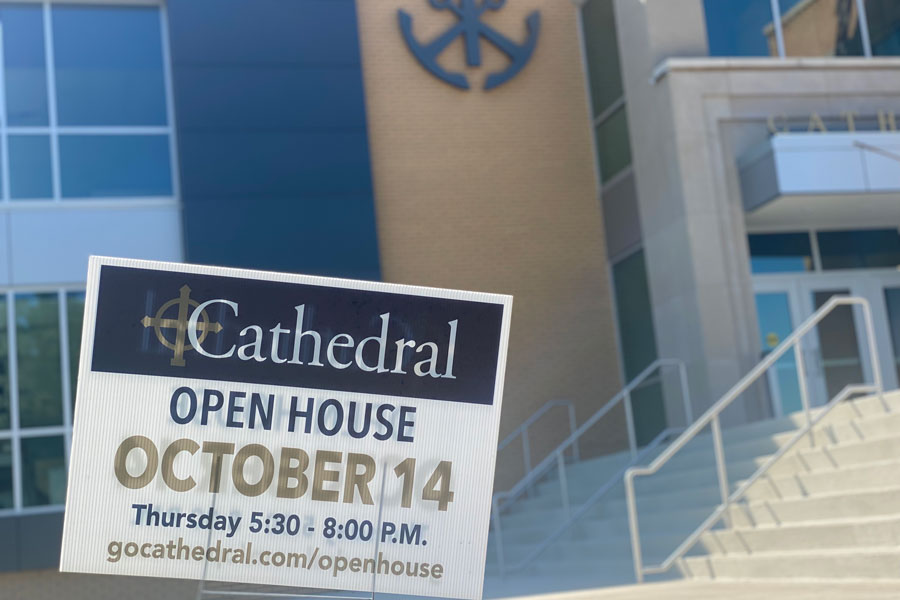 A sign outside the main entrance promotes this years Open House.