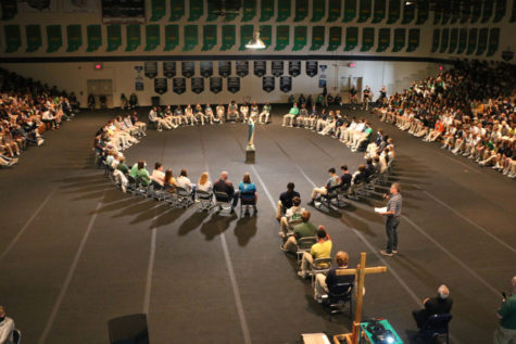 Director of campus ministry Mr. Dave Neeson  makes comments to the gathered student body during the praying of the rosary on Oct. 8.